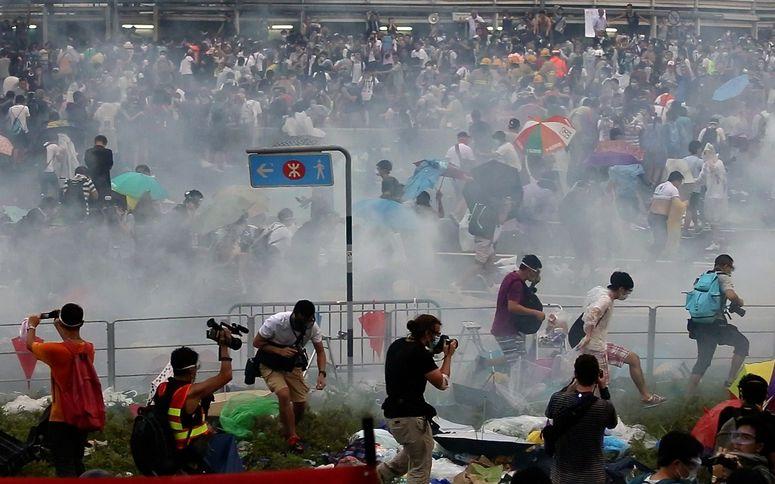 Manifestações no domingo, reprimidas pela Polícia. Crédito Aaron Tam/AFP